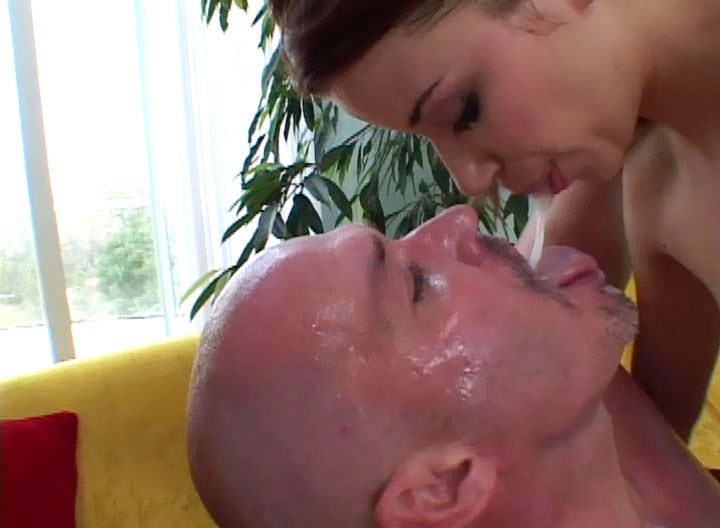 Cruel domina punishes her slave by spitting in his mouth